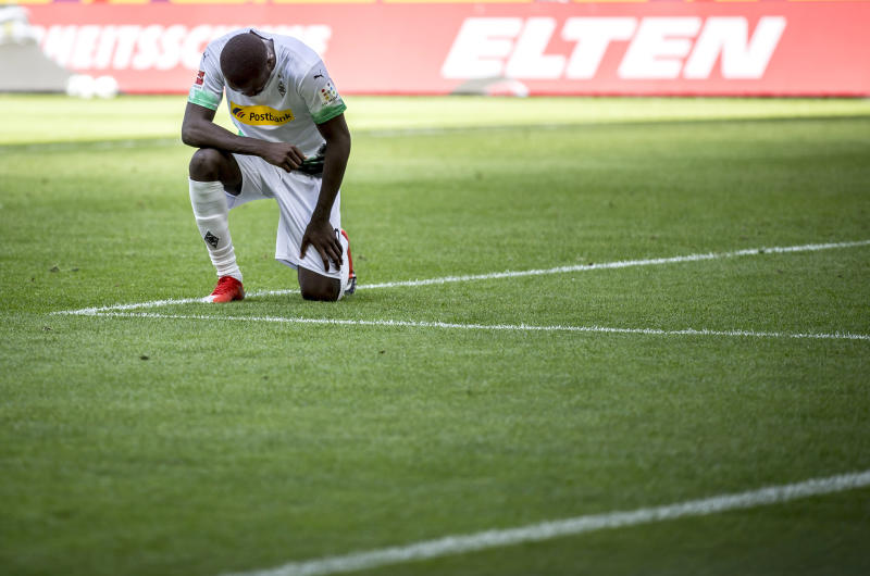 MOENCHENGLADBACH, GERMANY - MAY 31: Marcus Thuram of Borussia Moenchengladbach takes a knee after after he scores his Teams second goal during the Bundesliga match between Borussia Moenchengladbach and 1. FC Union Berlin at Borussia-Park on May 31, 2020 in Moenchengladbach, Germany. (Photo by Christian Verheyen/Borussia Moenchengladbach via Getty Images)