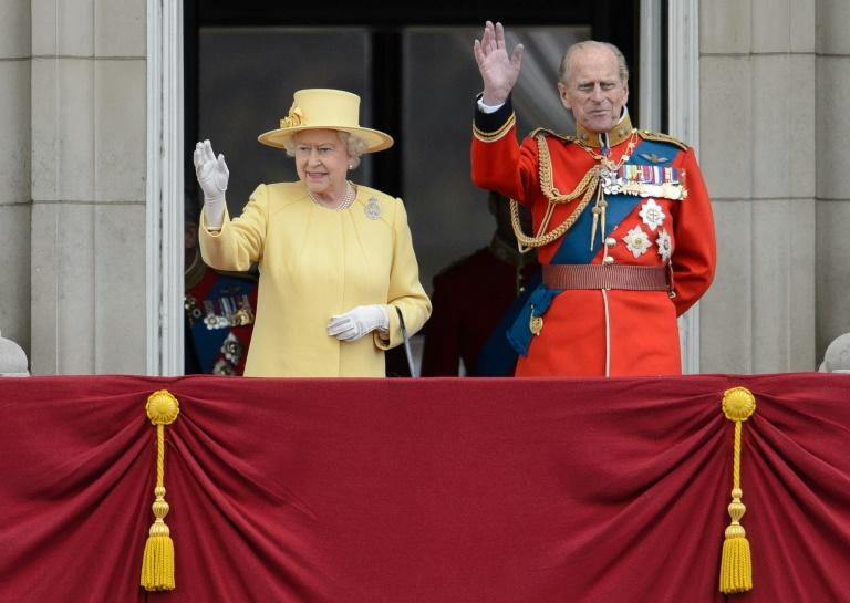 Queen Elizabeth II and Prince Philip stand on Buckingham Palace balcony following the 2012 'Trooping the Colour' parade at Horse Guards Parade in London