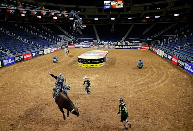 The bulls were bucking and the riders were riding, but the fans weren't there. (Photo by Kevin C. Cox/Getty Images)