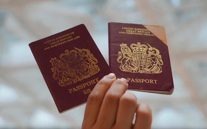 British National (Overseas) passports - Vincent Yu/AP