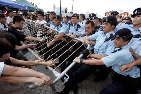 Activists fight to save the Queen's Pier in Hong Kong's financial district, August 1, 2007. ÊThe colonial-era pier in the city's financial heart became a civic battleground in 2007. The government wanted it removed for reclamation and roadworks, angering activists fighting to save what they viewed as a historic site. The saga reached boiling point in August when police forcibly evicted a band of activists and hunger strikers who had camped there for months. It was demolished in 2008. REUTERS/Paul Yeung/File photo