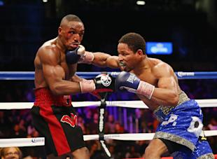 Shawn Porter punches Devon Alexander during their IBF welterweight title fight at the Barclays Center. (Getty)