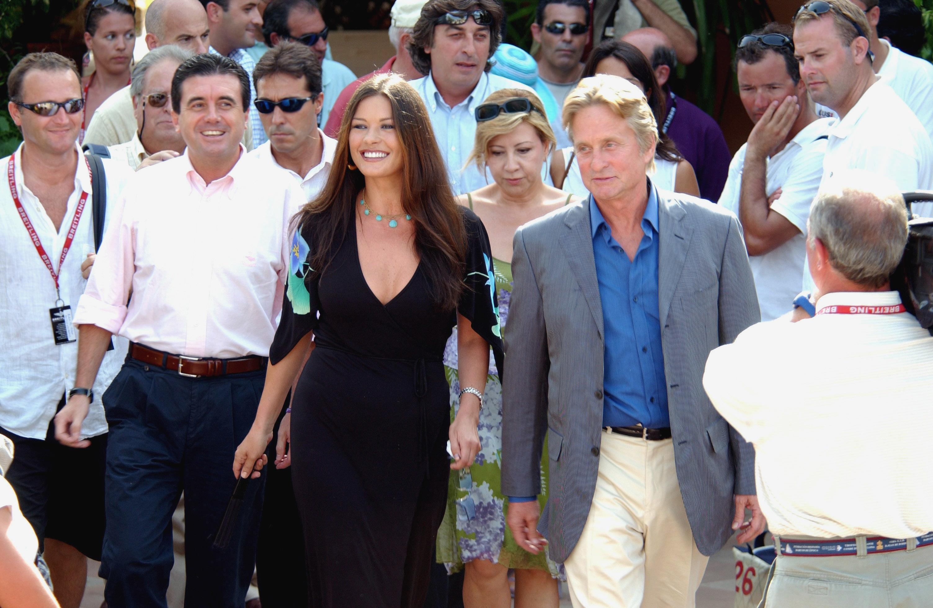Michael Douglas and wife Catherine Zeta-Jones visit Spain to support the candidacy of the city of Palma de Mallorca as the seat of the 32th America's Cup regatta in 2007. (Photo by Barmar/Corbis via Getty Images)