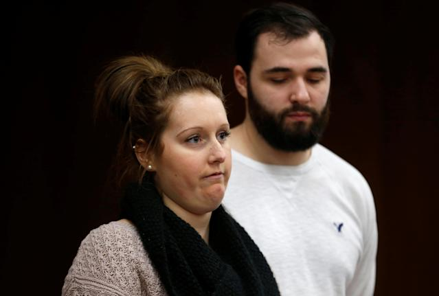 Former gymnast Valerie Webb gives a victim impact statement as her husband stands next to her during the sentencing hearing of Larry Nassar, a former team USA Gymnastics doctor who pleaded guilty in November 2017 to sexual assault charges, in the Eaton County Court in Charlotte, Michigan, U.S., February 2, 2018. REUTERS/Rebecca Cook