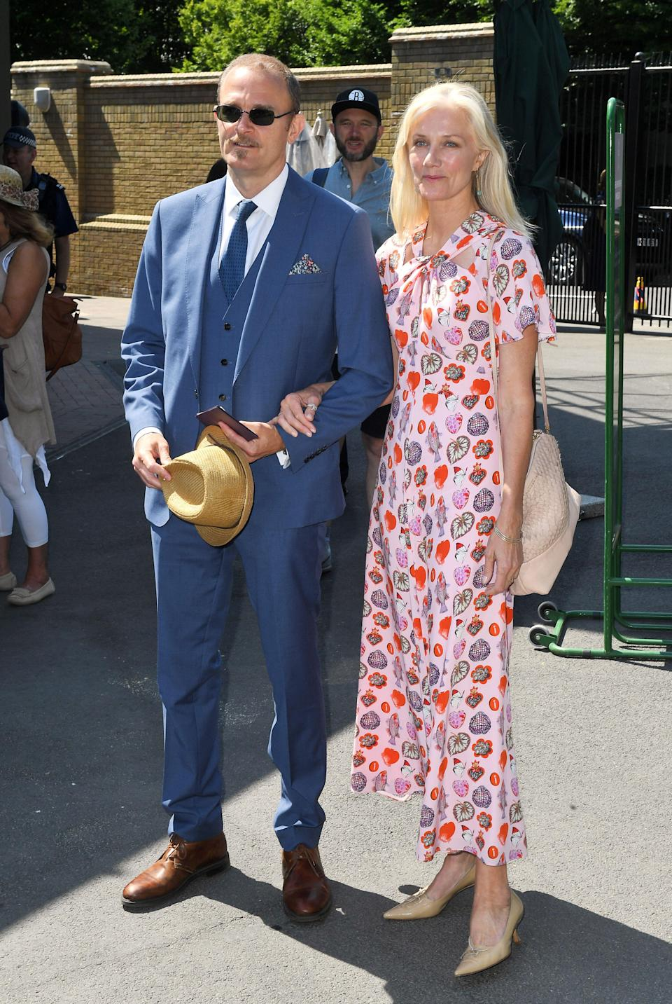 <p>Carlo Nero opted for a three-piece suit on day two of Wimbledon 2018 while Joely Richardson took to the royal box in an ankle-skimming ssummer dress and kitten heels. <em>[Photo: Rex]</em> </p>