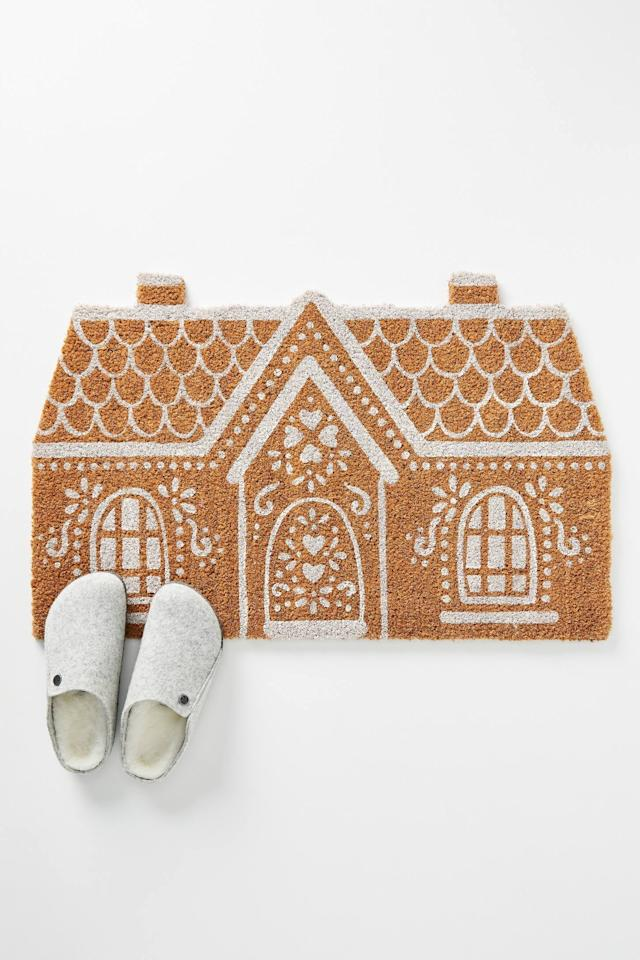 "<p>Allow guests to wipe their feet on an elaborate gingerbread house with the <a href=""https://www.popsugar.com/buy/Gingerbread-House-Doormat-502207?p_name=Gingerbread%20House%20Doormat&retailer=anthropologie.com&pid=502207&price=38&evar1=casa%3Aus&evar9=46615300&evar98=https%3A%2F%2Fwww.popsugar.com%2Fhome%2Fphoto-gallery%2F46615300%2Fimage%2F46767565%2FGingerbread-House-Doormat&list1=shopping%2Canthropologie%2Choliday%2Cchristmas%2Cchristmas%20decorations%2Choliday%20decor%2Chome%20shopping&prop13=mobile&pdata=1"" rel=""nofollow"" data-shoppable-link=""1"" target=""_blank"" class=""ga-track"" data-ga-category=""Related"" data-ga-label=""https://www.anthropologie.com/shop/gingerbread-house-doormat"" data-ga-action=""In-Line Links"">Gingerbread House Doormat</a> ($38).</p>"