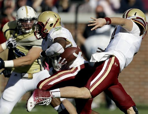 The ball comes loose on a hand off from Boston College quarterback Chase Rettig, right, to teammate Andre Williams, left, during the second quarter of an NCAA college football game against Georgia Tech, Saturday, Oct. 20, 2012, in Atlanta. (AP Photo/David Goldman)