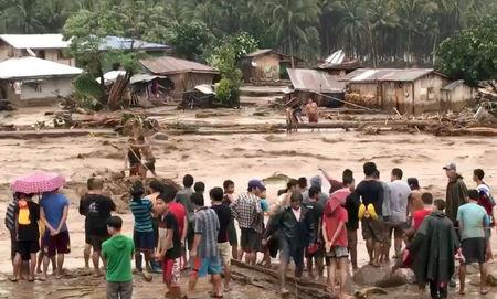 Almost 90 dead after storm triggers FLOODING and MUDSLIDES in the Philippines