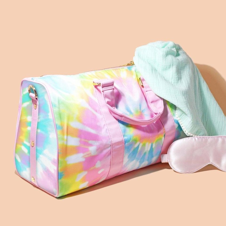 <p>Weekend road trips call for this <span>Stoney Clover Lane Tie Dye Mini Duffle Bag</span> ($168).</p>
