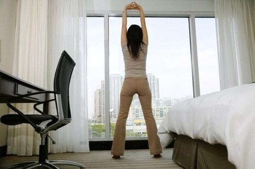 woman hotel stretching exercise
