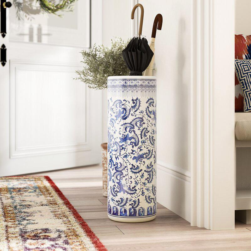 "<p>For lovers of all things chinoiserie or Dutch delft, this porcelain catch-all will fit right into your home. Plus, <a href=""https://www.marthastewart.com/1529000/how-shop-antiques-and-vintage-online"">it masks as an antique</a>: Thanks to its pattern, your guests won't know it's not vintage.</p> <p><strong><em>Shop Now: </em></strong><em>World Menagerie ""Akshaye"" Umbrella Stand, $84.99, <a href=""http://www.anrdoezrs.net/links/7799179/type/dlg/sid/MSL,UmbrellaStandsThatPullDoubleDutyasStorageandDècor,grello2,Hom,Gal,7615570,202002,I/https://www.wayfair.com/contractor/pdp/world-menagerie-akshaye-umbrella-stand-wdmg1342.html"" data-ecommerce=""true"" target=""_blank"" rel=""nofollow"" data-tracking-affiliate-name=""www.wayfair.com"" data-tracking-affiliate-link-text=""wayfair.com"" data-tracking-affiliate-link-url=""https://www.wayfair.com/contractor/pdp/world-menagerie-akshaye-umbrella-stand-wdmg1342.html"" data-tracking-affiliate-network-name=""CJ Deep Link"">wayfair.com</a></em>.</p>"