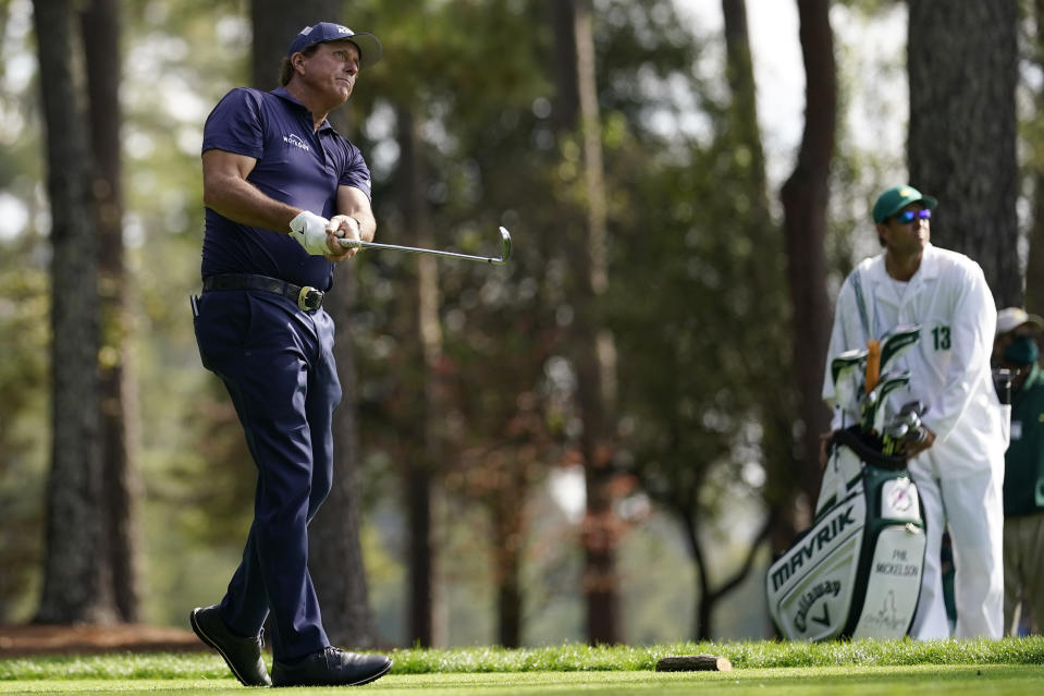 Phil Mickelson watches his drive on the fourth tee during the third round of the Masters golf tournament Saturday, Nov. 14, 2020, in Augusta, Ga. (AP Photo/David J. Phillip)