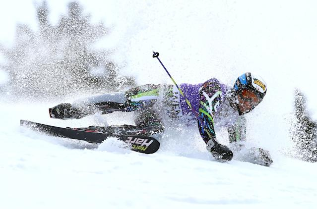 Japan's Naoki Yuasa crashes during the first run of an alpine ski, men's World Cup slalom, in Wengen, Switzerland, Sunday, Jan. 19, 2014. (AP Photo/Alessandro Trovati)