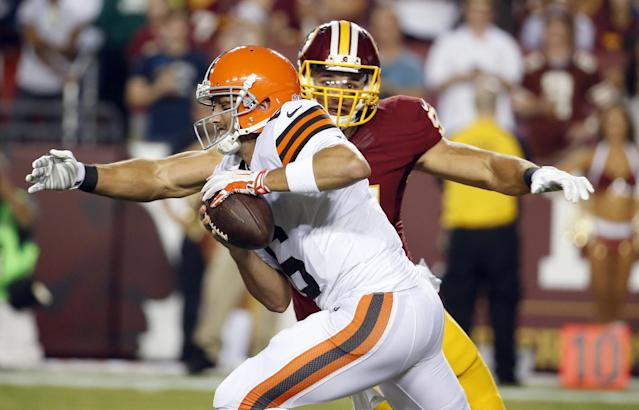 Washington Redskins outside linebacker Ryan Kerrigan sacks Cleveland Browns quarterback Brian Hoyer during the first half of an NFL preseason football game Monday, Aug. 18, 2014, in Landover, Md. (AP Photo/Alex Brandon)