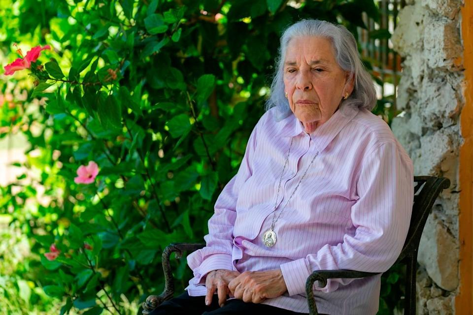 Ana Lazara Rodriguez, 82, sits outside of her home before holding a press conference in Miami, Florida on Thursday, May 6, 2021.