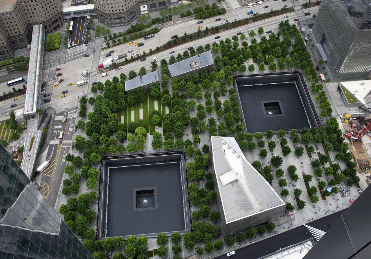 In this June 7, 2018 photo, the September 11 Memorial and Museum are seen from an upper floor of 3 World Trade Center in New York. The 80-story office building set to open this week at the World Trade Center will be the third completed skyscraper at the trade center site. (AP Photo/Mark Lennihan)