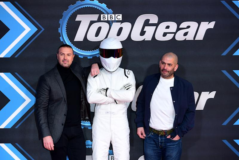Paddy McGuinness (left), The Stig (centre) and Chris Harris attending the Top Gear Season 28 Premiere held at Odeon Leicester Square, London.