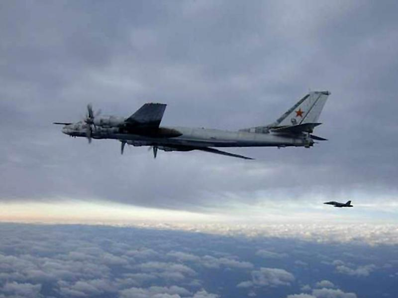 An F/A-18 Hornet escorts a Russian Tu-95 Bear bomber aircraft in February 2008 south of Japan: AFP/Getty