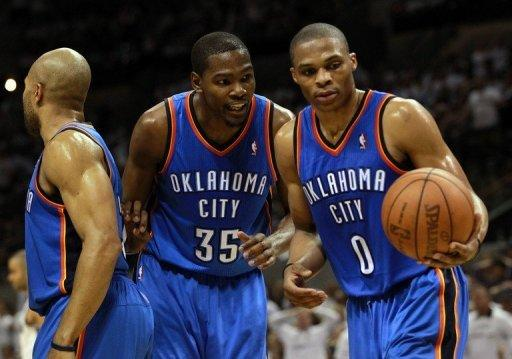 Oklahoma City Thunder's Kevin Durant (C) and Russell Westbrook (R) during game five of their NBA Western Conference Finals against the San Antonio Spurs on June 4. The Thunder and Miami Heat begin the best-of-seven championship series at Oklahoma City on Tuesday