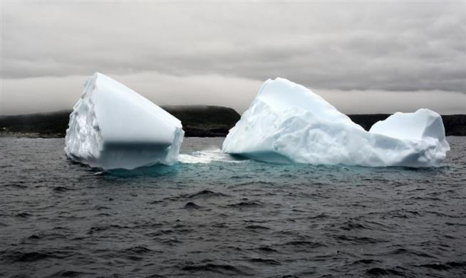 An iceberg seen near Cape Spear, Newfoundland, May 31, 2012, is one of many that has attracted early tourists to Canada's most eastern province this year. Icebergs break off glaciers in Greenland and Baffin Bay and drift south to the Grand Banks along a route known as Iceberg Alley.