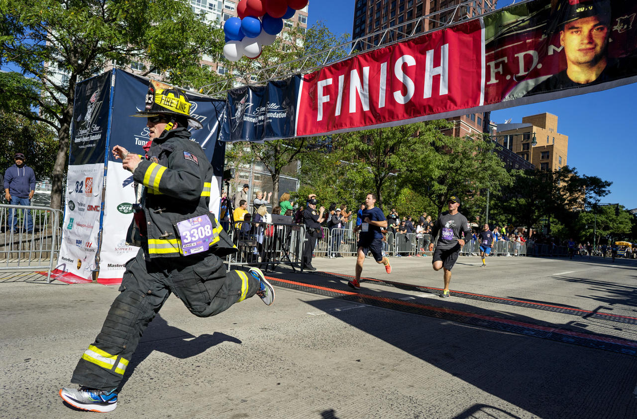 <p>Robert Sutherland, of Farmingdale, N.Y., a member of the East Farmingdale Fire Department, crosses the finish line during the Stephen Siller Tunnel to Towers memorial event in New York, Sept. 25 2016. The run honors New York firefighter Stephen Siller who made his way from his Brooklyn firehouse through the Hugh Carey Tunnel, then known as the Brooklyn Battery Tunnel, to the World Trade Center, where he died in the collapse of the towers on Sept. 11, 2001. (Photo: Craig Ruttle/AP) </p>