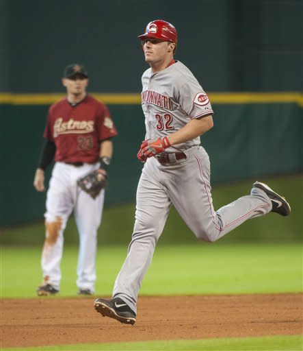 Cincinnati Reds' Jay Bruce (32) passes Houston Astros shortstop Tyler Greene (23) after hitting a three-run home run during the eighth inning of a baseball game onSunday, Sept. 2, 2012, in Houston. (AP Photo/Dave Einsel)