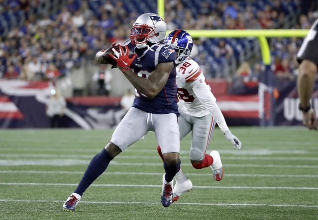 New England Patriots wide receiver Josh Gordon (10) catches a pass in front New York Giants defensive back Henre' Toliver of in the first half of an NFL preseason football game, Thursday, Aug. 29, 2019, in Foxborough, Mass. (AP Photo/Elise Amendola)