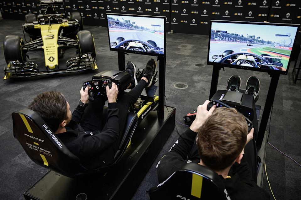 This photograph taken on November 25, 2019, shows member of the esport team Vitality, Jarno Opmeer (R) of the Netherlands and Renault Sport Academy Driver Max Fewtrell as they demonstrate their skills on the official esport F1 video game, at the Formula One motor racing Renault F1 Team headquarters in Enstone. (Photo by Philippe LOPEZ / AFP) (Photo by PHILIPPE LOPEZ/AFP via Getty Images)