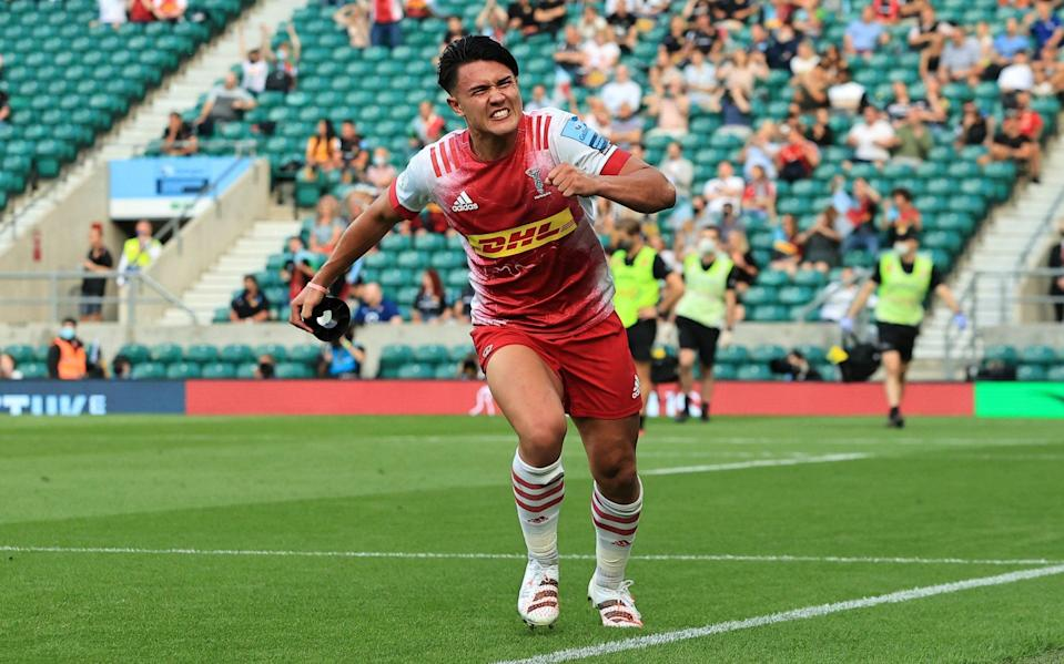 Marcus Smith of Harlequins celebrates after kicking a conversion to take the lead during the Gallagher Premiership Rugby Final between Exeter Chiefs and Harlequins at Twickenham Stadium on June 26, 2021 in London, England. - GETTY IMAGES