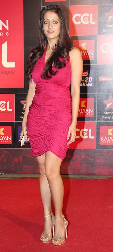 Curvaceous Raima Sen stands pretty in her textured deep pink halter dress.
