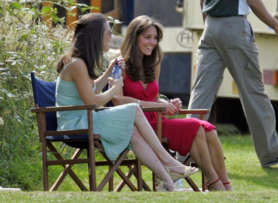 <p>Watching Prince William compete in the Chakravarty Cup charity polo match with sister Pippa Middleton. </p>