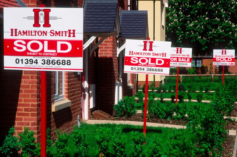 Property market estate agent signs saying Sold outside new housing, Rendlesham, Suffolk, England. (Photo by: Geography Photos/UIG via Getty Images)