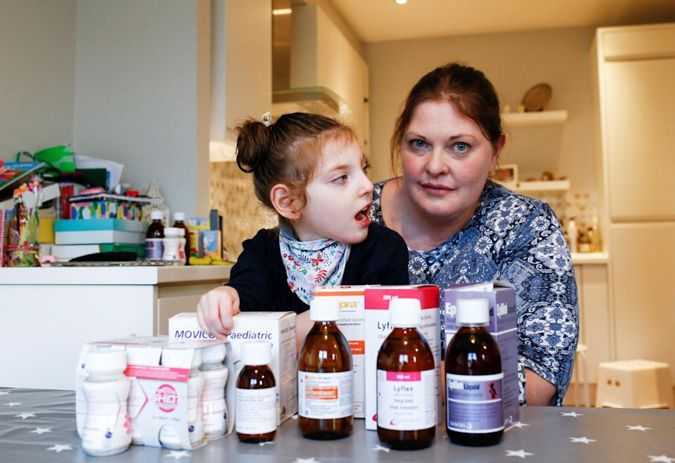 Jo Elgarf is seen with her daughter Nora and the child's prescription medicine at their home in London, Britain, January 30, 2019. Picture taken January 30, 2019. REUTERS/Henry Nicholls