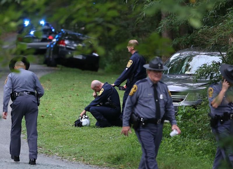 A Virginia law enforcement officer cries near the site of a state police helicopter crash, which killed two state troopers. (Shelly Cousino / The Daily Progress)