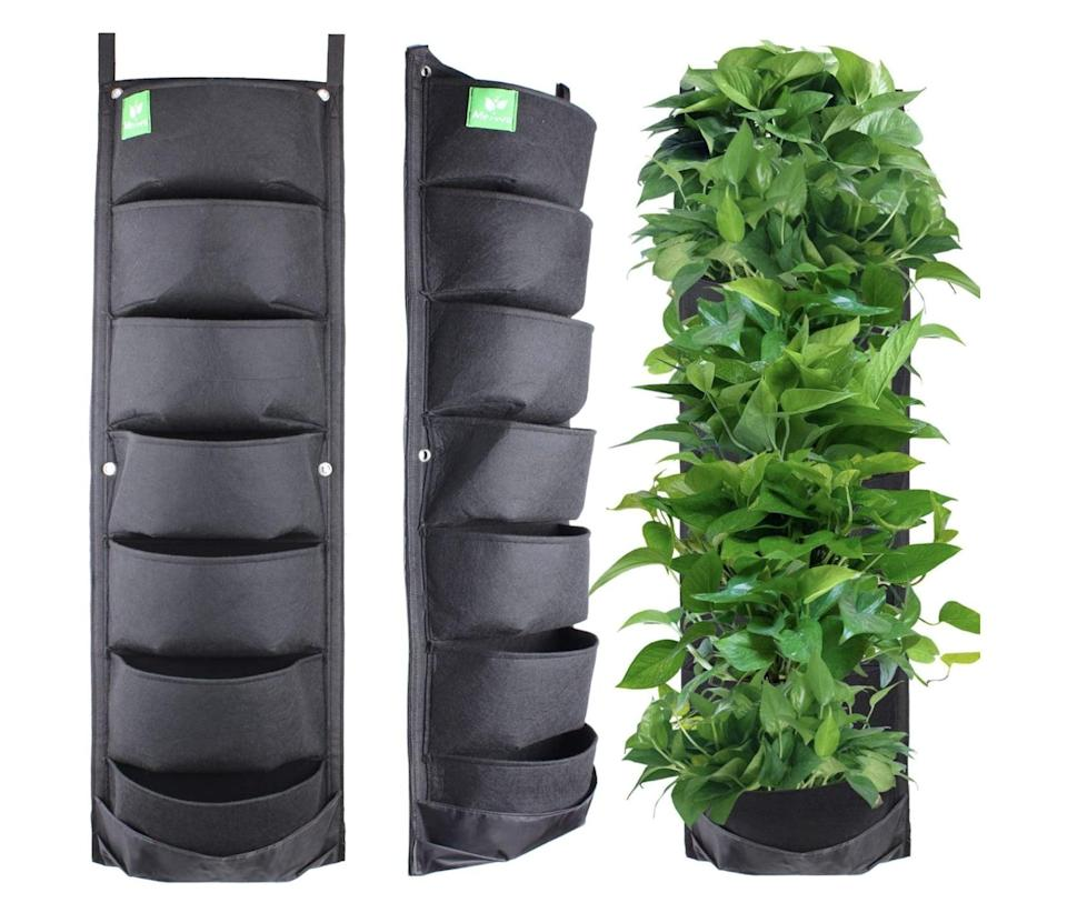 <p>Suitable for inside or outside, the <span>Meiwo 7-Pocket Hanging Vertical Garden</span> ($14) does not take up a lot of space and makes for unique wall decor. </p>