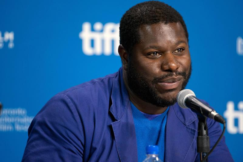 """FILE - This Sept. 7, 2013 file photo shows director Steve McQueen during the press conference for """"12 Years a Slave"""" at the 2013 Toronto International Film Festival in Toronto. The film is being hailed a masterpiece and a certain Oscar heavyweight. (AP Photo/The Canadian Press, Galit Rodan, File)"""