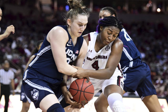 South Carolina forward Aliyah Boston (4) battles for a rebound against Connecticut guard Anna Makurat, left, during the first half of an NCAA college basketball game Monday, Feb. 10, 2020, in Columbia, S.C. (AP Photo/Sean Rayford)