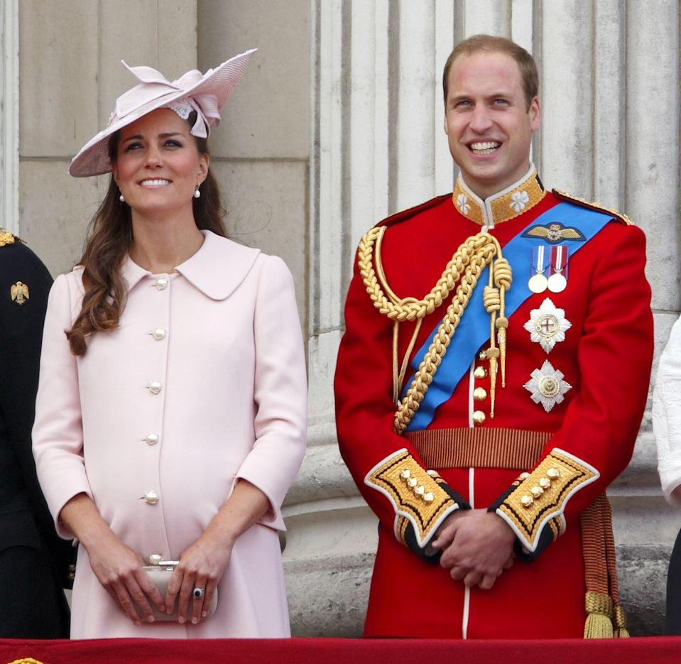 """<p>Much like the royal women before her, tailored coat dresses (and coat-dress combinations) would prove to be a staple of Kate Middleton's <a href=""""https://www.goodhousekeeping.com/beauty/fashion/g4674/kate-middleton-pregnancy-style/"""" rel=""""nofollow noopener"""" target=""""_blank"""" data-ylk=""""slk:maternity wardrobe"""" class=""""link rapid-noclick-resp"""">maternity wardrobe</a>. This blush A-line coat dress with pearl buttons by Alexander McQueen that the Duchess wore to the Trooping the Colour in 2013 is the epitome of timeless design. </p>"""
