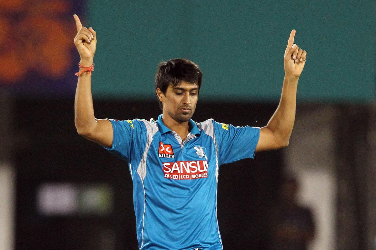 Rahul Sharma of Pune Warriors India celebrates getting Unmukt Chand of Delhi Daredevils wicket during match 39 of the Pepsi Indian Premier League between The Delhi Daredevils and the Pune Warriors India held at the Chhattisgarh International Cricket Stadium in Raipur on the 28th April 2013. (BCCI)