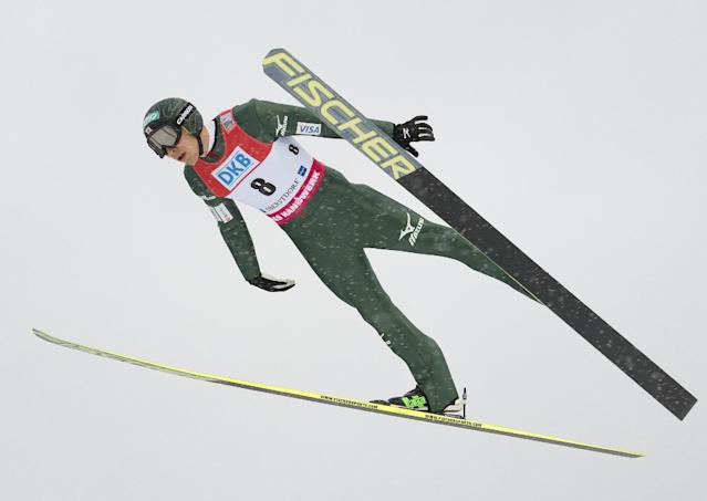 Yusuke Minato of Japan soars through the air during the individual Gundersen competition at the Nordic Combined FIS World Cup in Oberstdorf, southern Germany, Sunday, Jan. 26, 2014. (AP Photo/Jens Meyer)