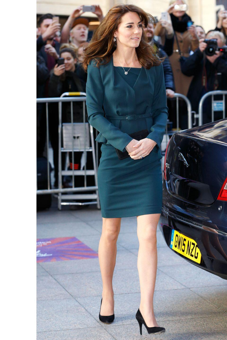 <p>The Duchess arrives at an ICAP charity event in Central London, donning a deep teal suit and pointy black pumps.</p>