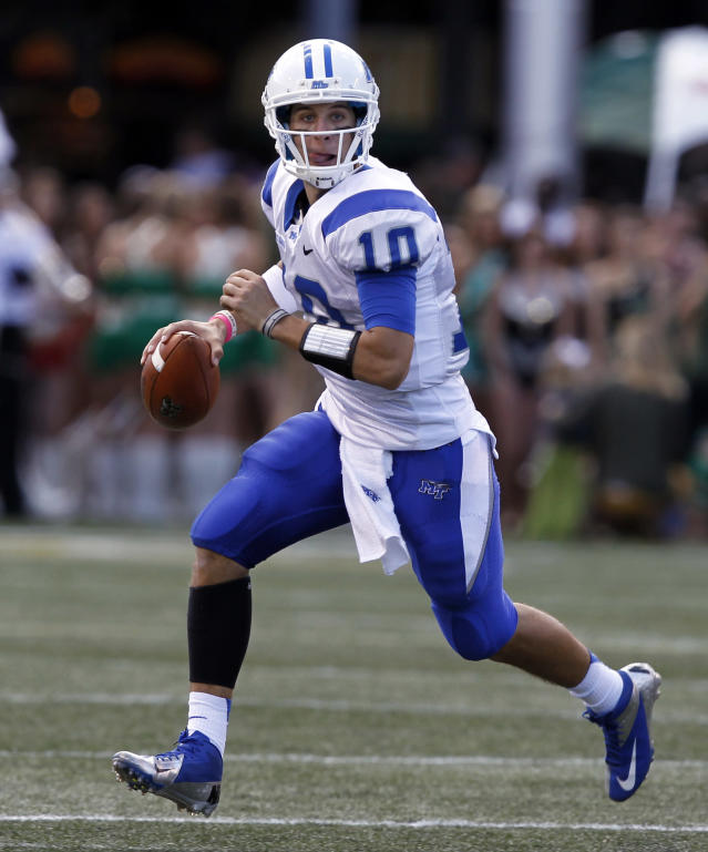 Middle Tennessee State quarterback Logan Kilgore (10) scrambles away from pressure during the first half of an NCAA college football game against UAB on Saturday, Nov. 2, 2013, in Birmingham, Ala. (AP Photo/Butch Dill)