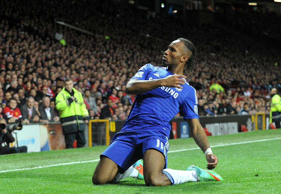 Chelsea's Didier Drogba celebrates scoring a goal during their English Premier League match against Manchester United, at Old Trafford in Manchester, north-west England, on October 26, 2014 (AFP Photo/Paul Ellis)
