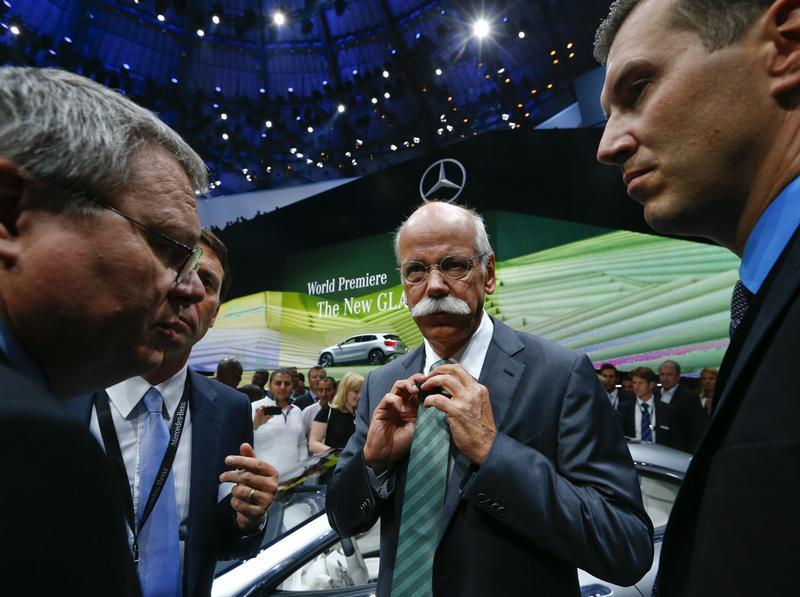 Daimler Chief Executive Zetsche adjusts his tie during the presentation of the new SUV Mercedes GLA on a media preview day at the Frankfurt Motor Show