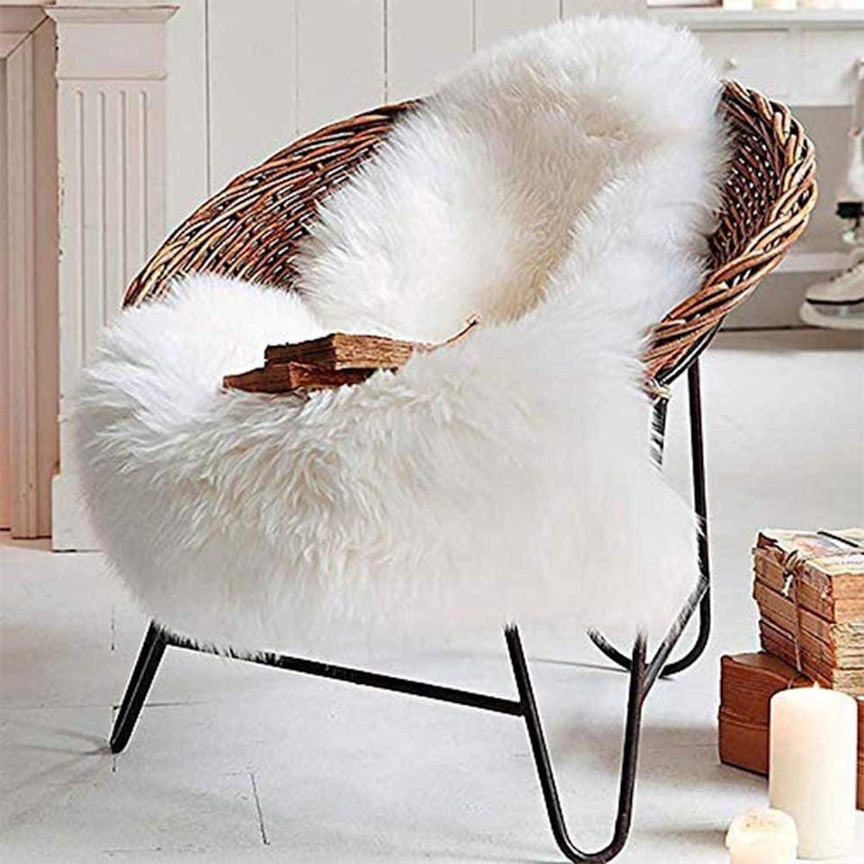 <p>You can put this <span>Lochas Deluxe Supersoft Fluffy Shaggy Faux-Sheepskin Rug</span> ($20) pretty much anywhere.</p>