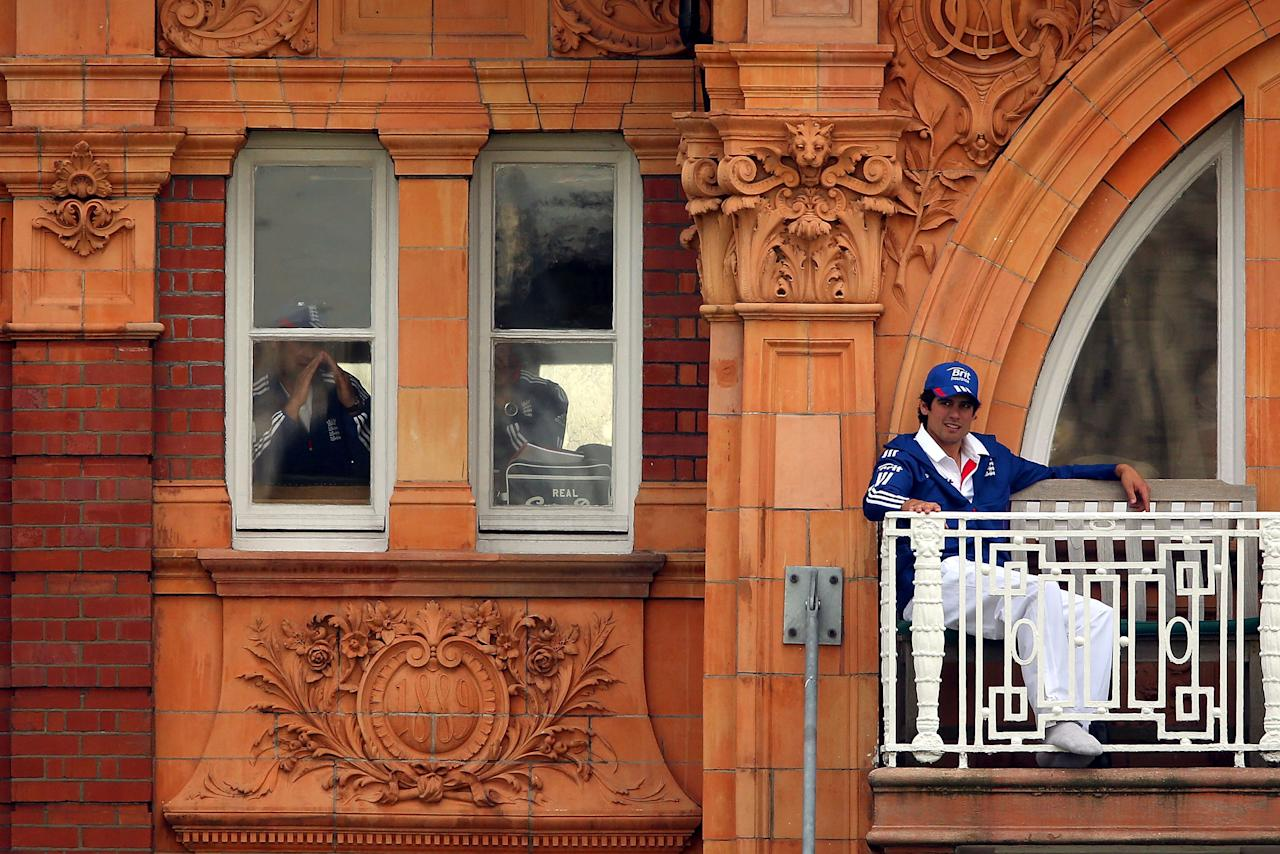 LONDON, ENGLAND - MAY 16:  Alastair Cook of England looks on from the balcony during day one of 1st Investec Test match between England and New Zealand at Lord's Cricket Ground on May 16, 2013 in London, England.  (Photo by Clive Rose/Getty Images)
