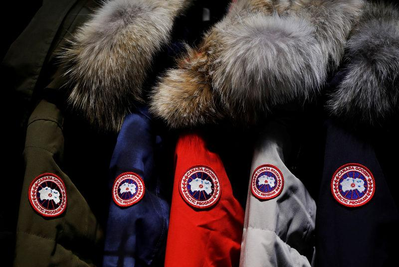 Jackets hang in the showroom of the Canada Goose factory in Toronto
