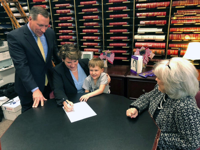 Amy McGrath officially files papers to challenge Senate Majority Leader Mitch McConnell, Friday, Dec. 27, 2019 in Frankfurt, Ky. Calling her party's victory in the Kentucky governor's race a jolt of momentum for her own bid to unseat a Republican incumbent, Democrat Amy McGrath on Friday officially filed to challenge Senate Majority Leader Mitch McConnell in what looms as a bruising, big-spending campaign next year. (AP Photo/Bruce Schreiner)