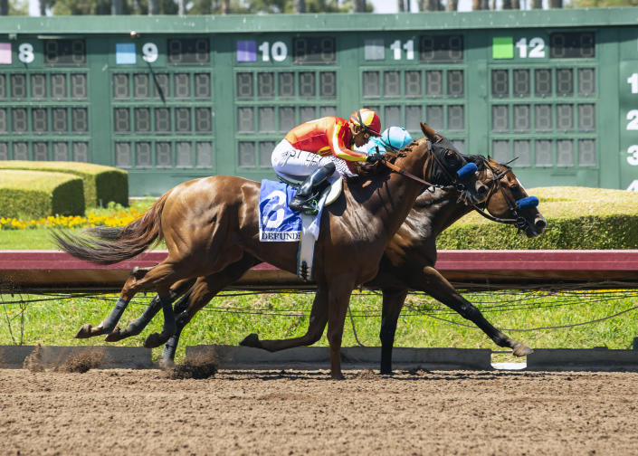In this photo provided by Benoit Photo, Classier and jockey Mike Smith, right, hold off stablemate Defunded and jockey Abel Cedillo to win the Grade III $150,000 Los Alamitos Derby horse race, Sunday, July 4, 2021, at Los Alamitos Race Course, in Cypress, Calif. (Benoit Photo via AP)