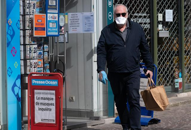 A man is pictured wearing a mask and gloves in Nantes on 20 March. France has had more than 10,800 confirmed cases. (Getty Images)